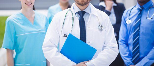 team-of-doctors-standing-together-in-hospital-premises_107420-84768